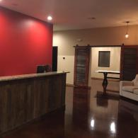 We have added a statement wall with bold, red paint to complement the rich amber woods and dark flooring.