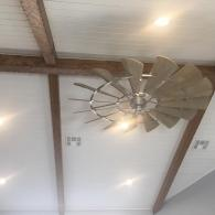 This ceiling fan is an eclectic treasure that adds character to this newly built home.
