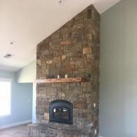 Nothing adds luxury to a home quite like a rustic brick fireplace and hardwood floors!